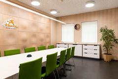 Height adjustable meeting table, filing cabinets, monoblock visitor chairs, perforated 3D acoustic wall panels, bended plywood LED ceiling lamp